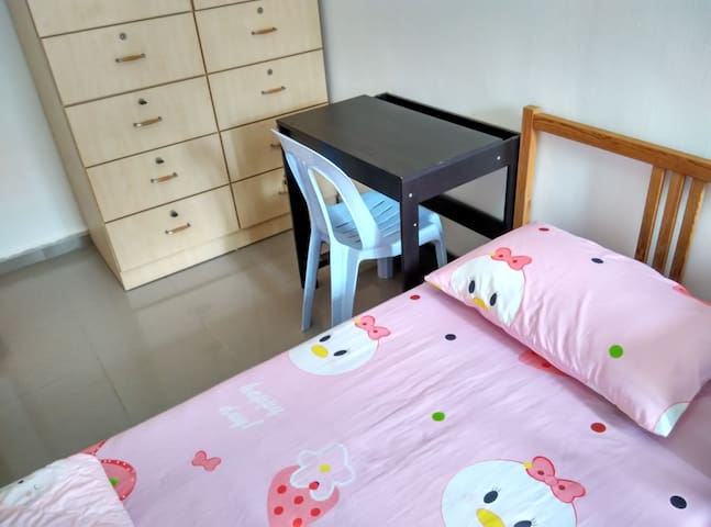 Solid single bed with a comfortable 6-inch spring mattress, a clean mattress protector, a clean bed sheet, a clean warm blanket and a clean comfortable pillow. Plus a big wardrobe, a desk and a chair.
