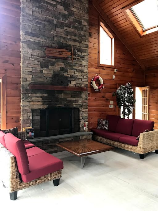 Pool room living area with gas fireplace