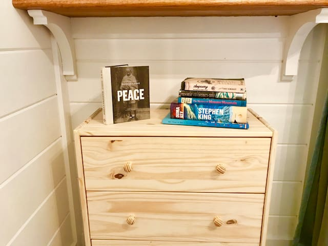 Pine dresser 2 of 2 in the bedroom. Read from our selection of Maine-themed, coastal and comfort books