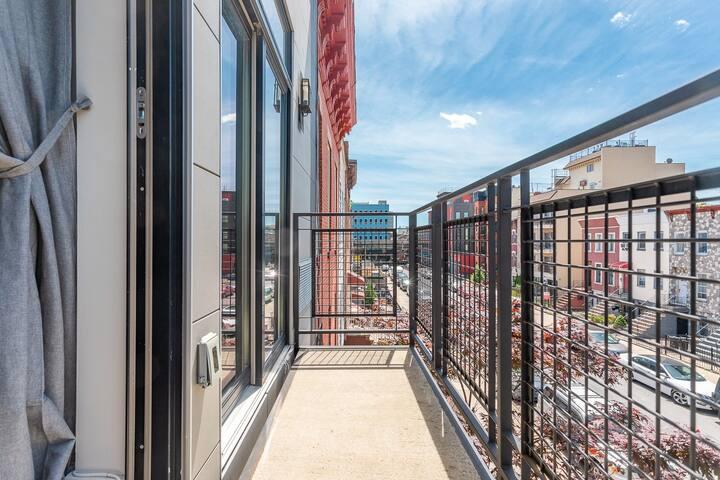 Chic, modern Studio with balcony access