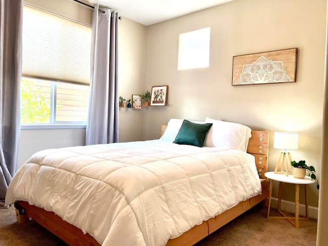 2nd floor bedroom 3.  Queen bed with new Sealy Posturepedic mattress, luxurious linens, tall dresser, and closet for clothing storage during your stay.