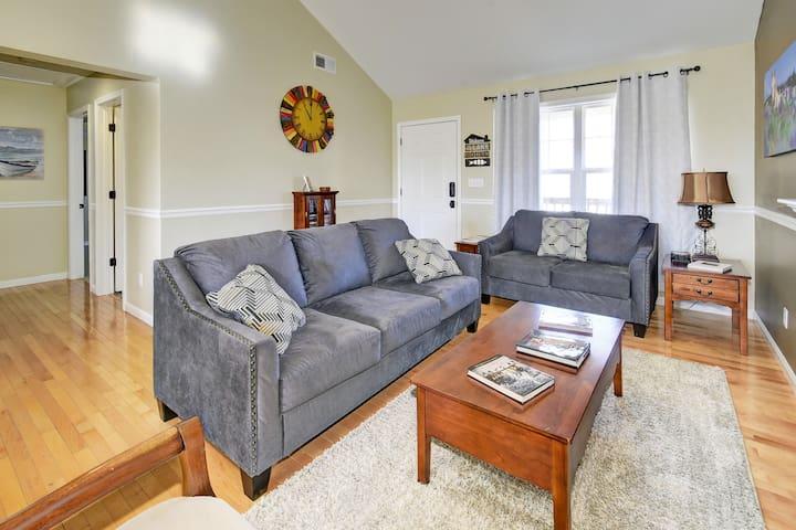 Living area with full sleeper sofa, gas fireplace and seasonal decor.