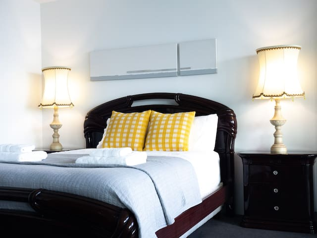 Luxurious master suite with queen bed, Italian furniture and vintage lamps. Large glass sliding doors for complete privacy and block out blinds