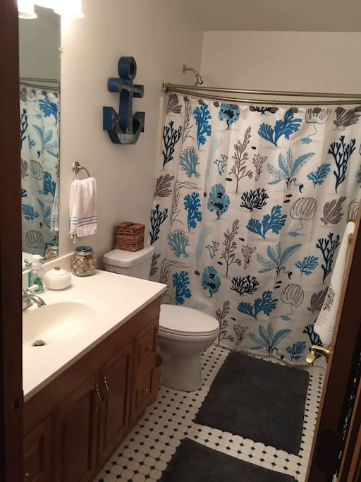Spacious  shower /tub combination in private bathroom.