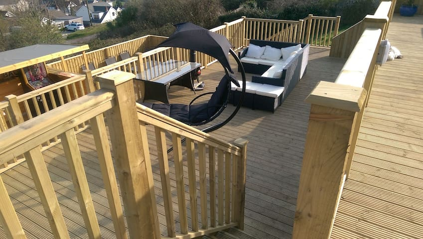 3 Tier decking with hot tub, sun loungers and bar...  Hot Tub is available all year round