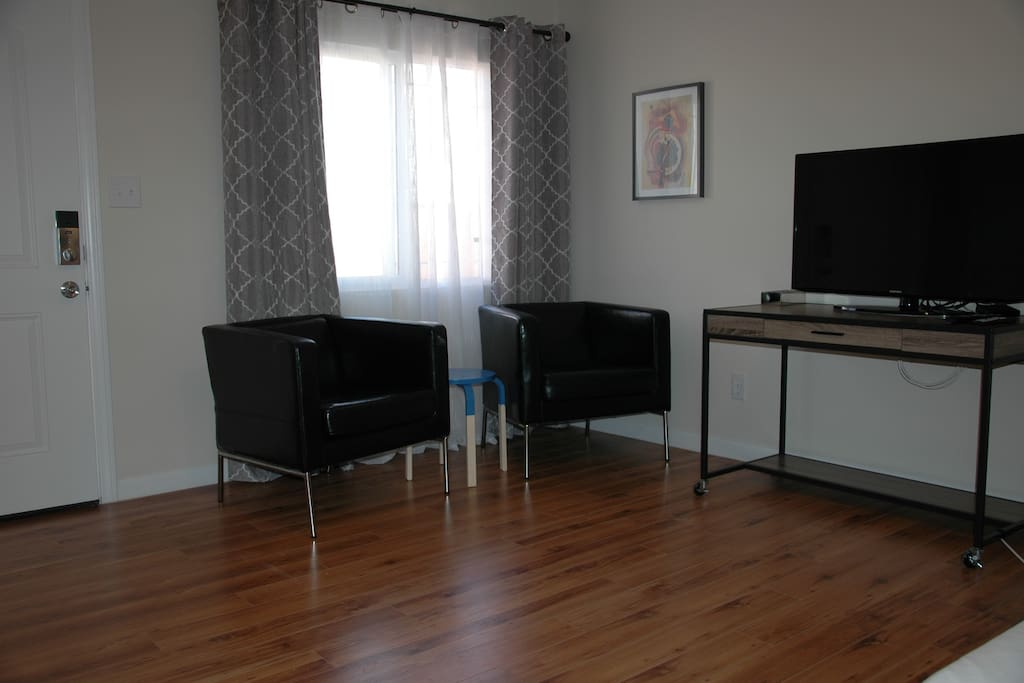 Armchairs and work space. HDTV with streaming grade internet