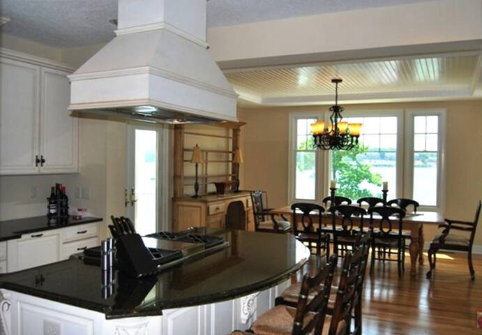 Fantastic gourmet kitchen with ample preparation space for your family gathering. Off of the kitchen is a mud room, laundry room and exterior covered patio.