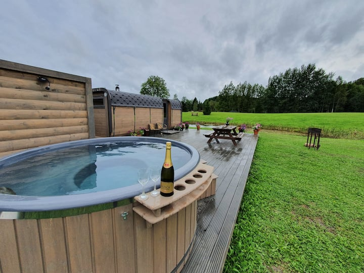 Sauna + hot tube +barrel shaped pod all for you.