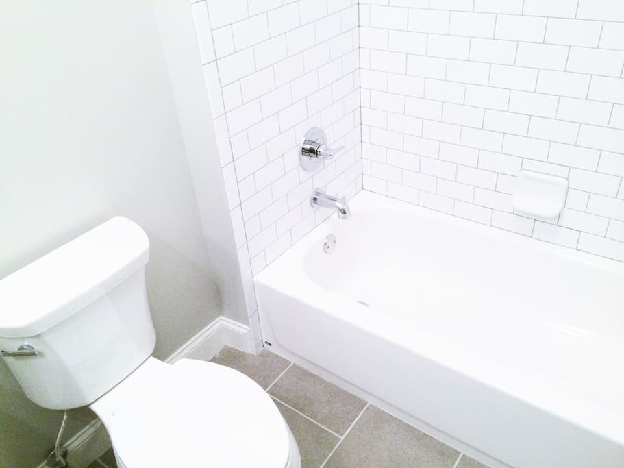 Luxe Bath with Subway Tile & European Fixtures!