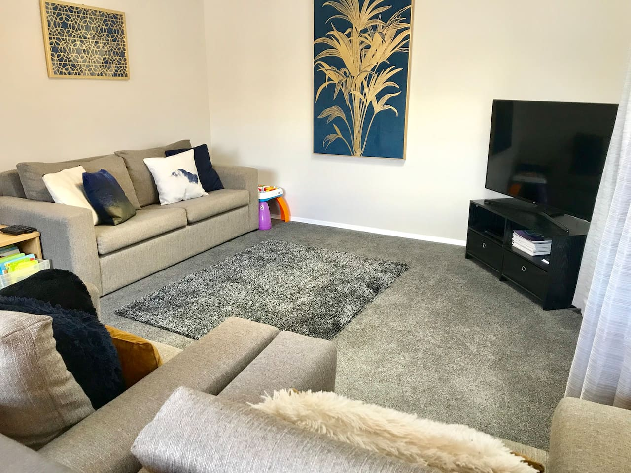 The new look lounge at Central Townhouse. We have just added a carpet, and a sky light and taken out the fire place. The TV is large and you can go online or access your Netflix account. The Heat Pump will keep you warm and comfortable in winter.
