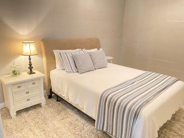 Queen bedroom in the basement .