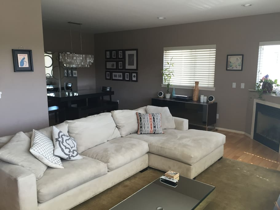 Open format living room leading into dining area