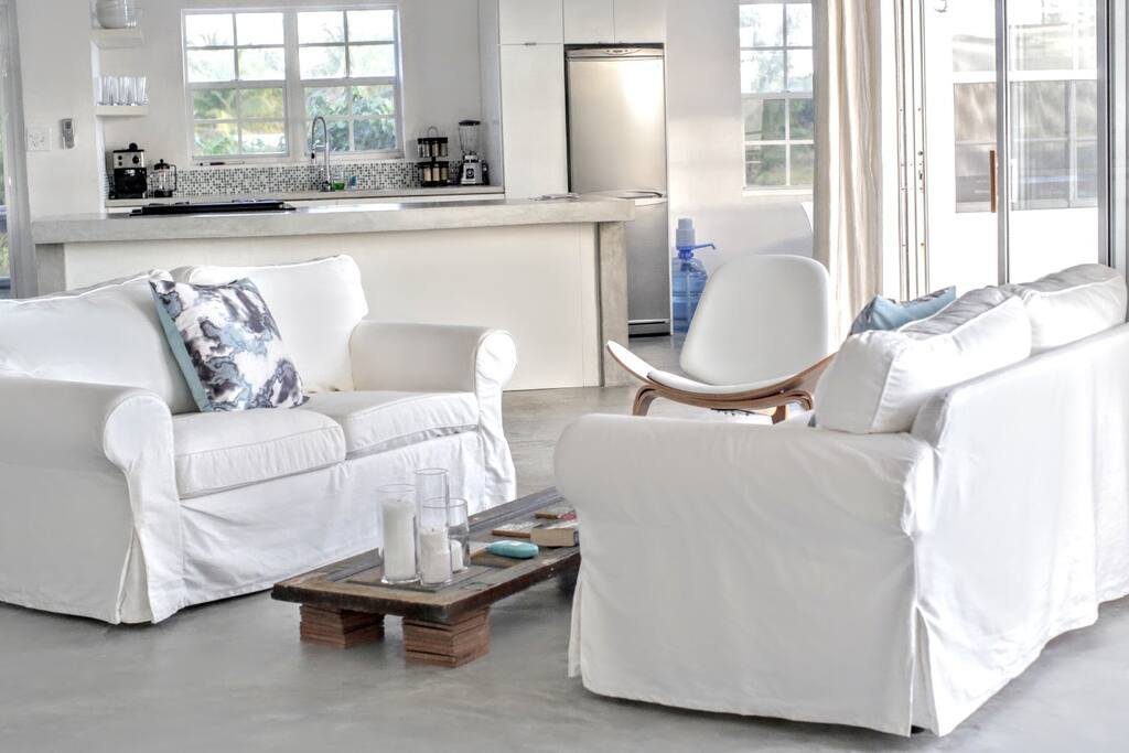 Gorgeous comfy white couches with a view to die for!