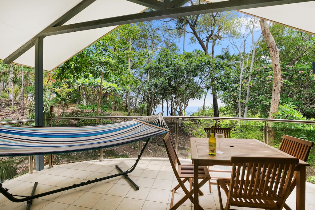 The top patio of the townhouse has beautiful views of the ocean, the parkland and you can take it all in from your own hammock and enjoy the Barbeque provided.