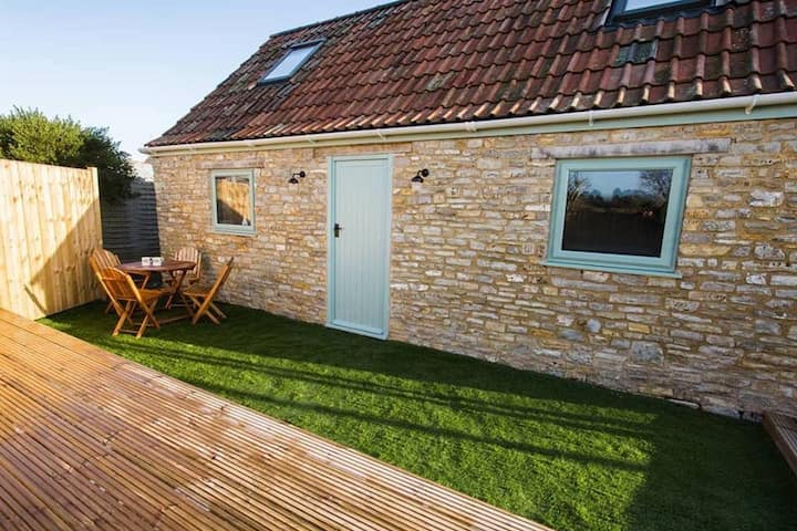 Beautiful renovated barn, in main family garden.