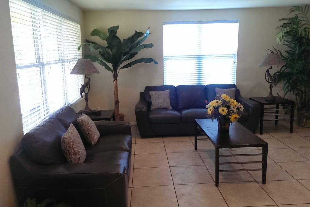 Upper unit - Spacious living room area with large LCD TV.