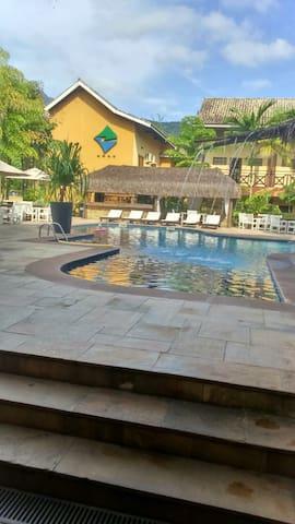 Flat em Hotel 4* frente para o mar