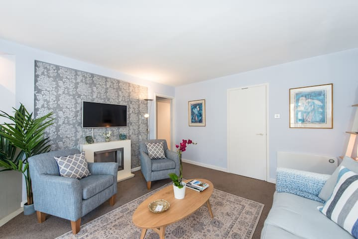 The living room has been decorated using  light and soft colours for you to enjoy of a relaxing atmosphere after a day out
