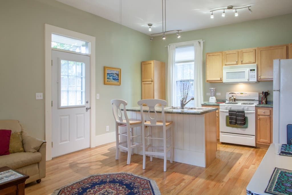 Kitchen is an open design great room into living