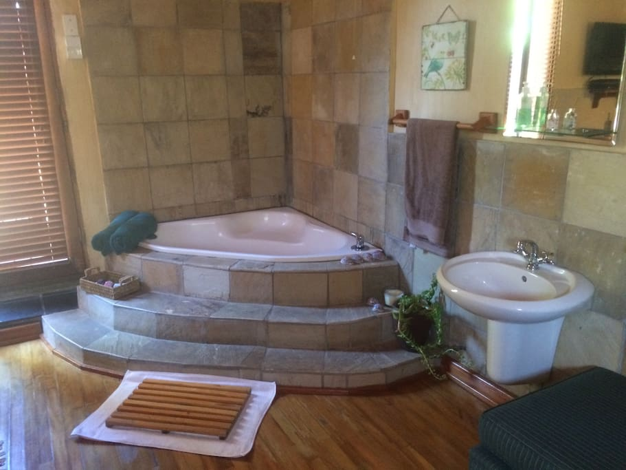 Romantic corner tub in the room.
