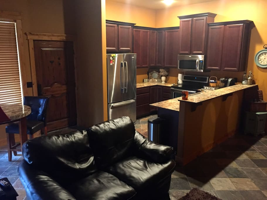 This is the kitchen with stainless steel appliances, microwave, keurig coffee maker and dishwasher.