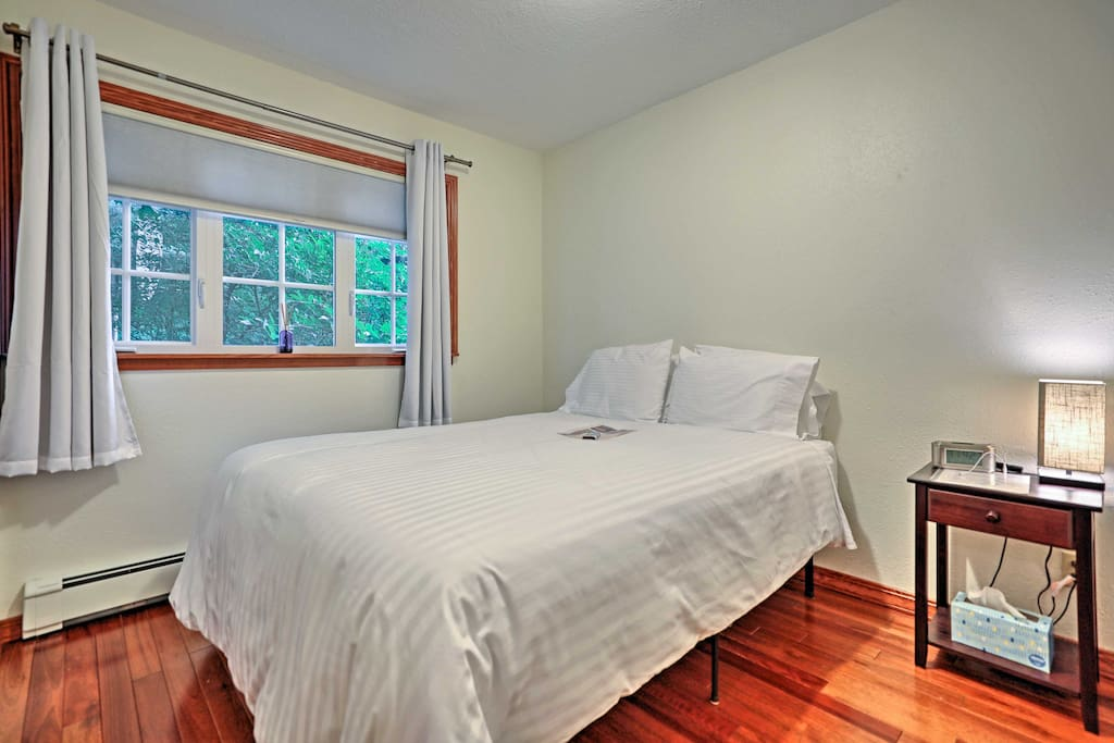Relax in your queen sized memory foam bed on the first floor with hardwood floors throughout the house