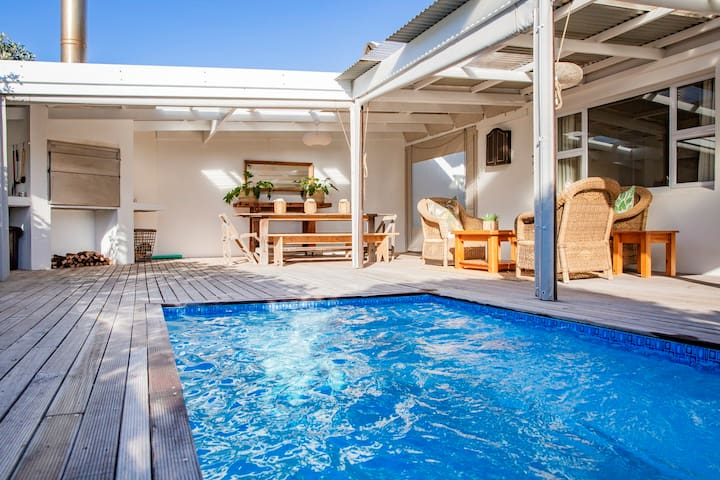 Enjoy a short walk to the beach, a private pool & BBQ deck!
