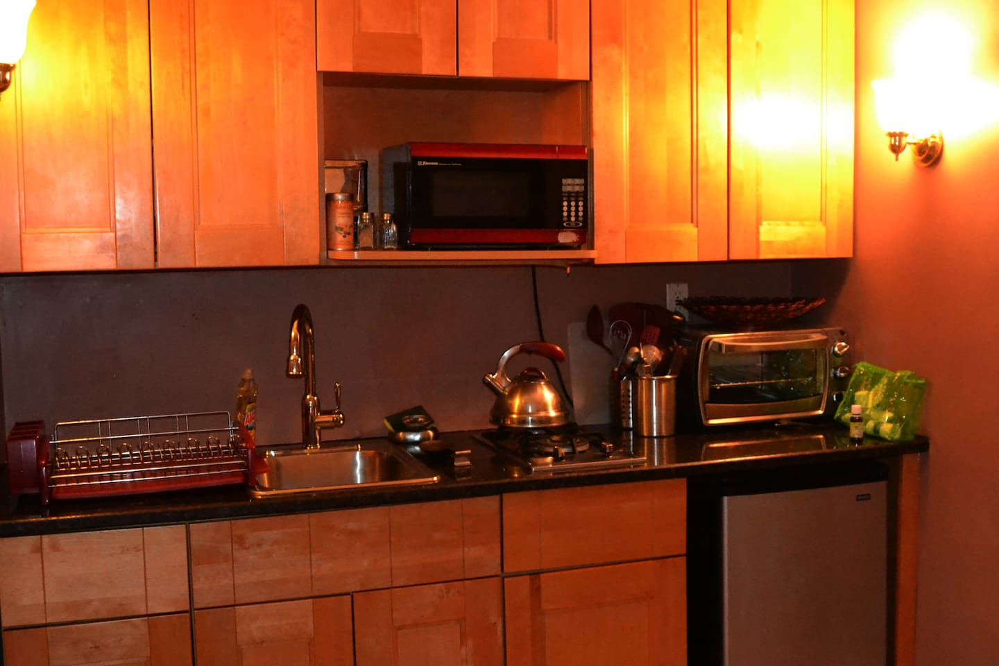 The kitchenette has stainless steel appliances, an under-counter refrigerator, and a granite countertop. The kitchenette is fully loaded with plates, pots, pans, utensils, serving dishes, wine glasses (very important), and much more....