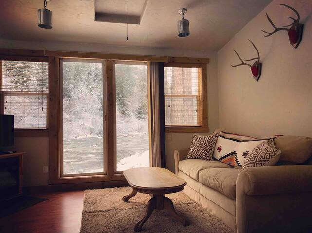 Enjoy the view of the river from the comfy couch