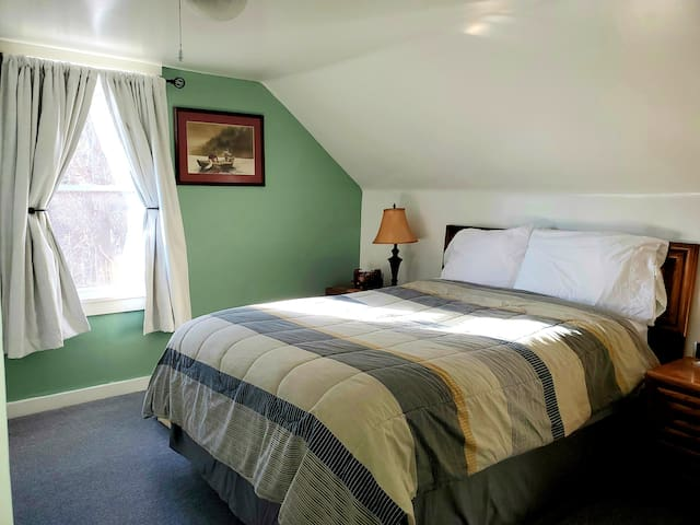 This is the third bedroom also with a full size bed. Extra blankets and pillows in amour. Air-conditioner provided in summer.