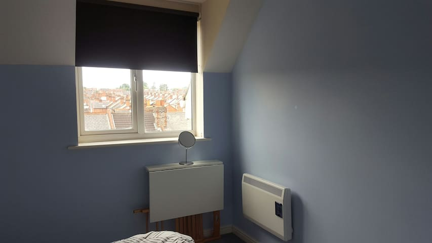 That's a pull up desk and the heat can be switched on in your room.