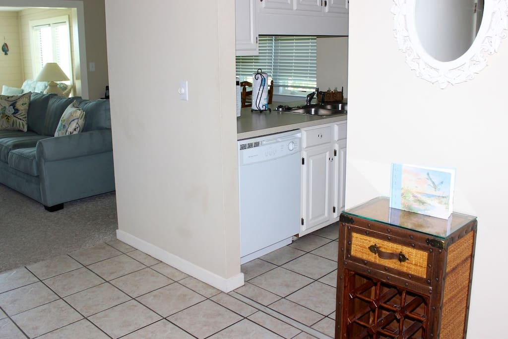 The entry hall has tile floor & opens to a large living area with a sunroom.