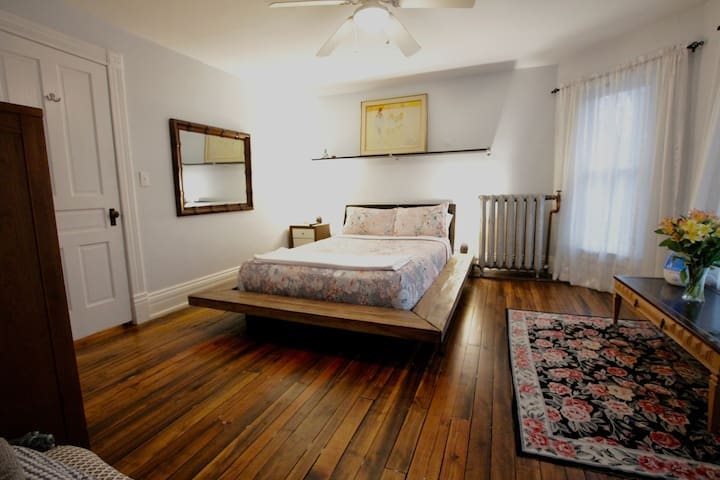 """Bedroom 2. A comfortable queen-size bed, 50"""" television with apple tv and Hulu, Netflix, Amazon Prime, and HBO accounts ready to use."""