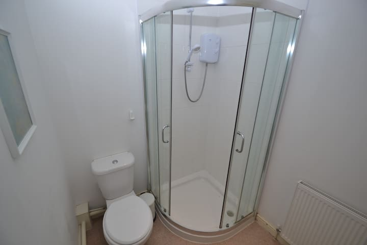 Clean bathroom with electric shower