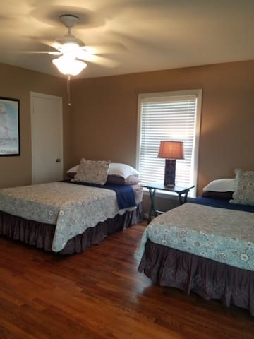 Bedroom 2 includes (2) double beds and dresser