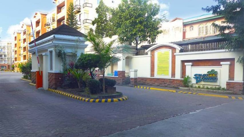 Front gate w/ 24/7 Security guards, where taxi cabs and tricycles await passengers.