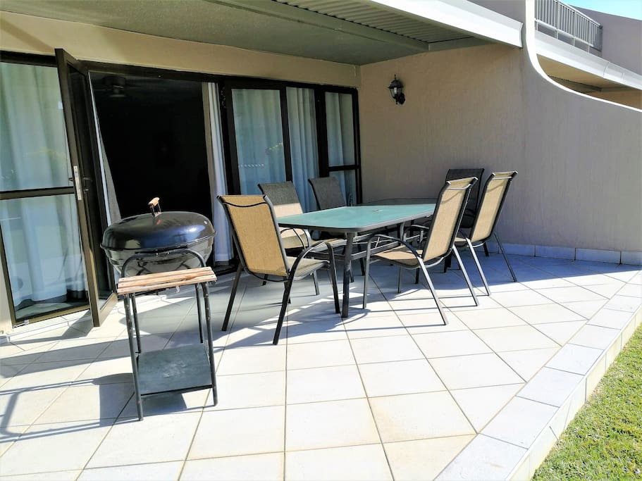 Patio with braai barbeque. The patio is off the lounge, and leads onto the garden and pool area.