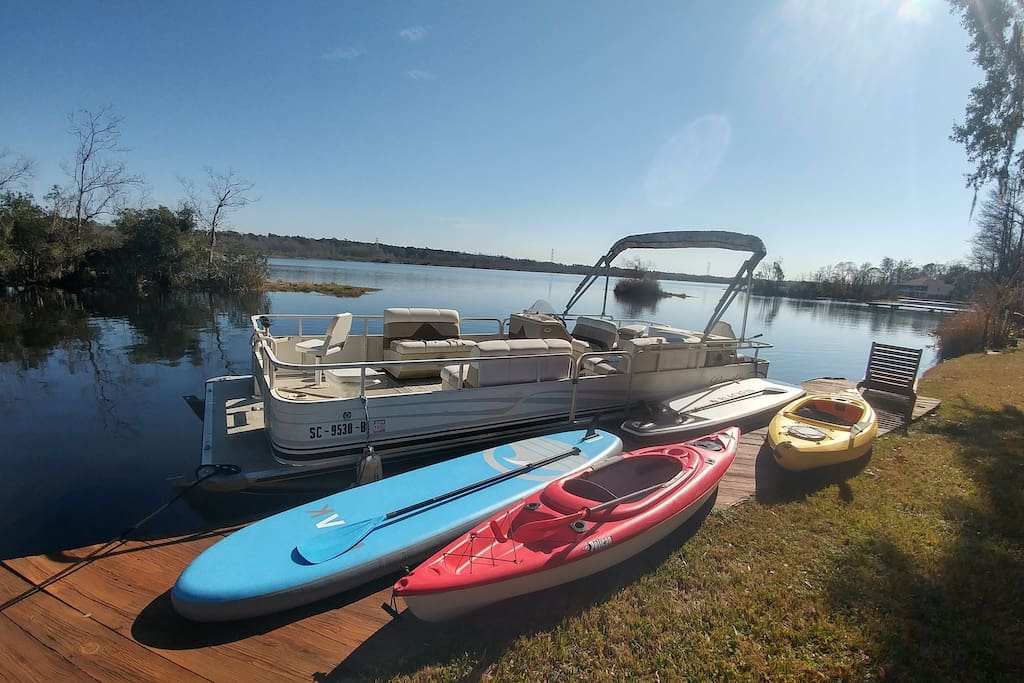 2 single person kayaks and 2 inflatable paddle boards for use