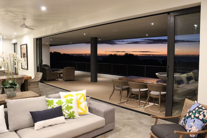 Indoor and outdoor flow with multiple lounging areas and unobstructed views