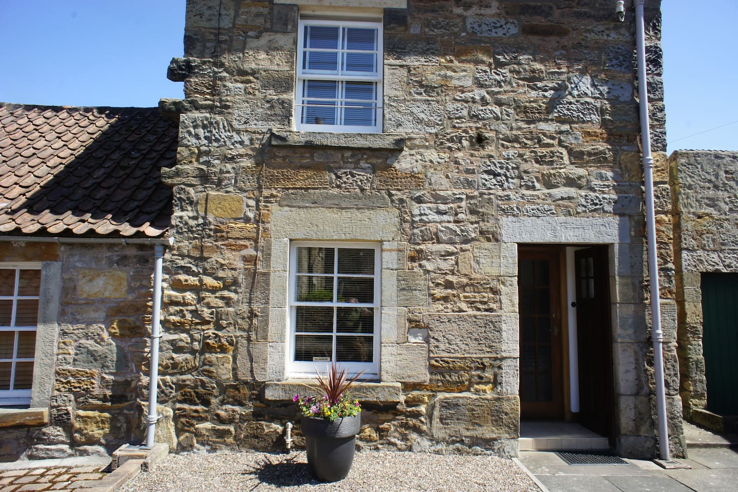 Outside of property, a traditional sandstone mill workers cottage, Five minutes walk to town centre