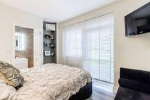 "En-suite master bedroom with a Samsung TV 36"""