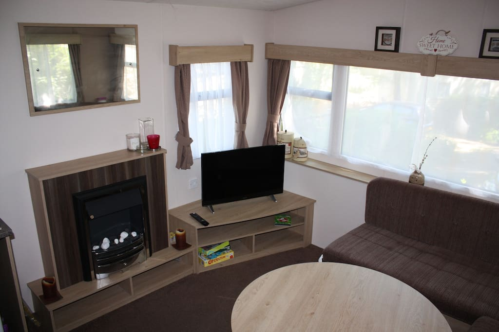 """Living room with 32"""" TV/DVD, Gas Fire, Dining Table, Pull-out Bed Settee"""