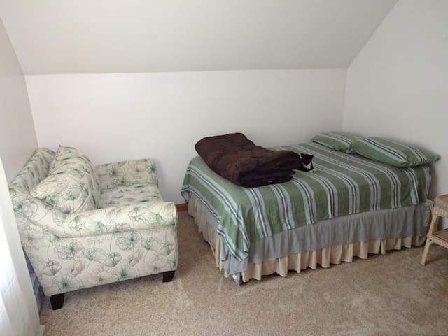 Full size bed and love seat.