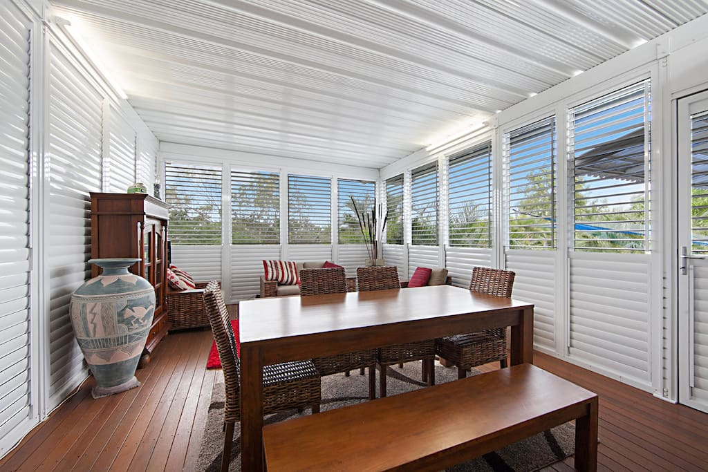 Large enclosed patio with louvre shutters & flyscreens