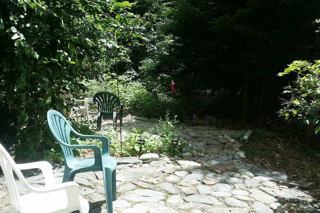 Private back yard is yours, with firepit,and connecting stone patios with lots of raspberry and blackberry plants all about! All this and only a three-minute walk to the backshore! The surf can be heard constantly!