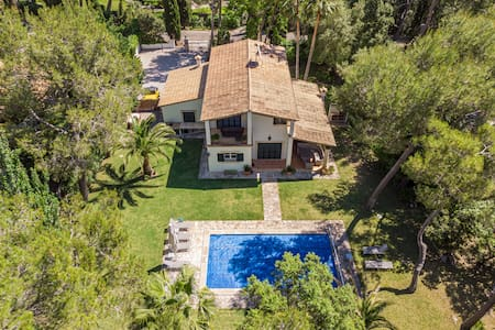 A modern family villa with large garden and pool