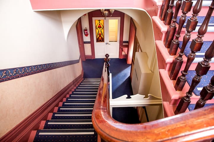 Stairwell adjoining top and bottom residence.