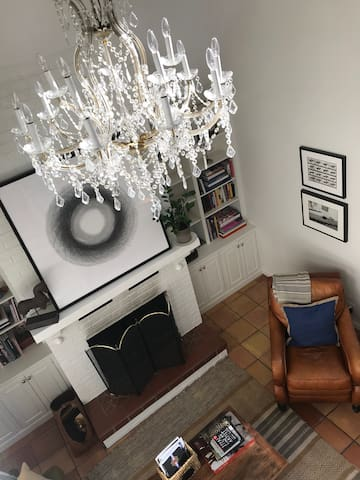 Museum-quality art is hung throughout the home, which is decorated with luxe textures and materials.