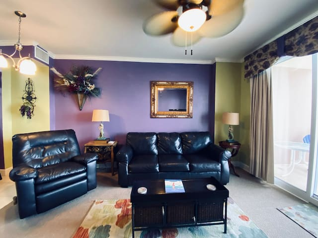 Relax in our spacious living room with a couch that doubles as a sleeper sofa and perfectly situated to overlook the emerald waters of the gulf and the entertainment center.
