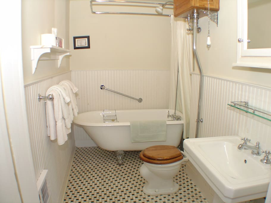 Private ensuite four-piece bath with marble floor. Enjoy a hot shower or a deep soak.